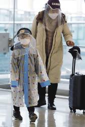 在韓國仁川國際機場,乘客採取防護措施.jpg