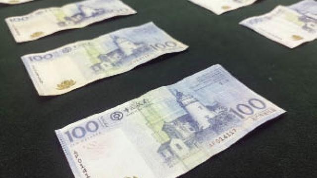酒店外僱上班印偽鈔 珠澳兩地散貨終落網 司警檢逾三萬影印錢