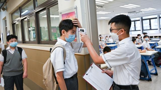 小學分兩階段陸續復課_跨境生每七日核酸測試
